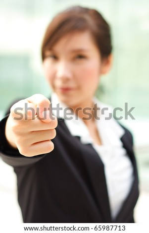 Bright portrait of business woman pointing at you