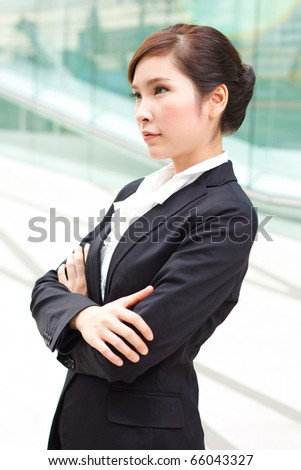 Bright portrait of business woman with arms crossed