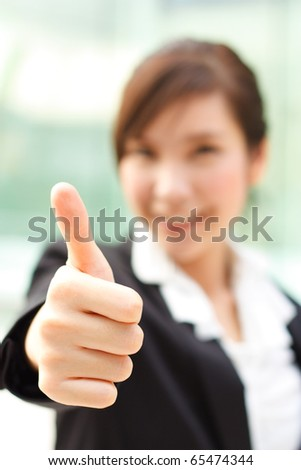 Bright portrait of lady showing thumb up