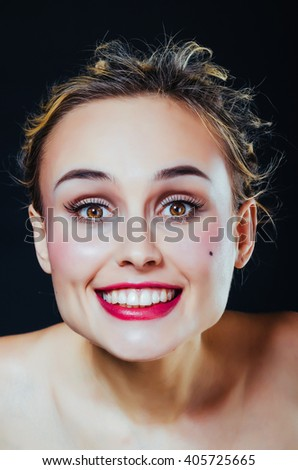 Bright portrait of young smiling woman - stock photo