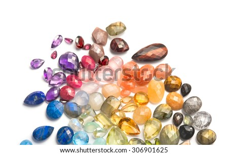 Bright real gemstones on the white background. Many different colorful precious and semiprecious gems. - stock photo