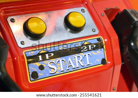 bright red arcade machine with the two buttons - stock photo
