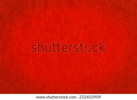Bright red background from organic handmade paper with fibers texture, suitable for Christmas and New Year greeting cards, romantic and festive moments. - stock photo