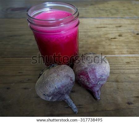 Bright Red Beet Juice in Mason Jar - stock photo
