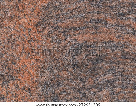 bright red brown granite with dark veins and black spots in the large slab - stock photo