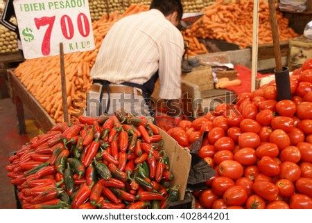 Bright red chilis and fresh tomatoes  - stock photo
