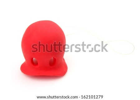 Bright red clown's nose with a sting isolated on white - stock photo