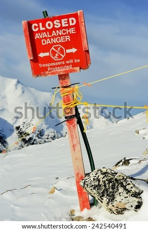 Bright Red Danger Sign - Closed for Avalanche - Marmot Basin, Jasper National Park - stock photo
