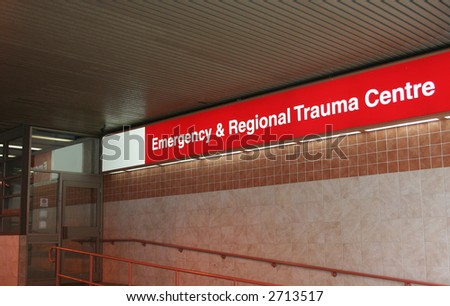 Bright red Emergency room sign on Hospital building - stock photo