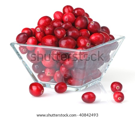 Bright red fresh cranberries in a square glass bowl - stock photo