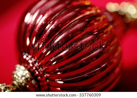 bright red glass Christmas ball close-up with blurred lights  bokeh on background  - stock photo