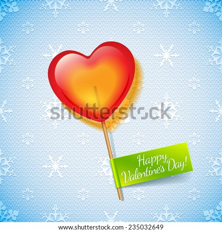 Bright red holiday heart lollipop on a blue lace background with mesh and white snowflakes and green label and wish a Happy Valentine's Day - stock photo