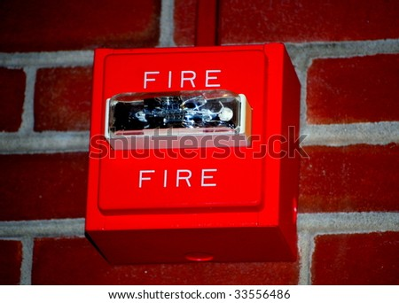 Bright Red Institutional Fire Alarm with light - stock photo