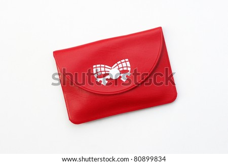 Bright Red Leather Change Purse Wallet with Bow isolated on a white background - stock photo