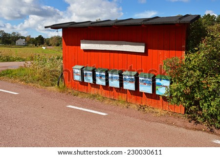 Bright red mail boxes on wall - stock photo