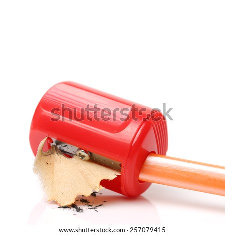 Bright red pencil knife-sharpener on a white background - stock photo