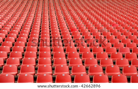 Bright red stadium seats - stock photo