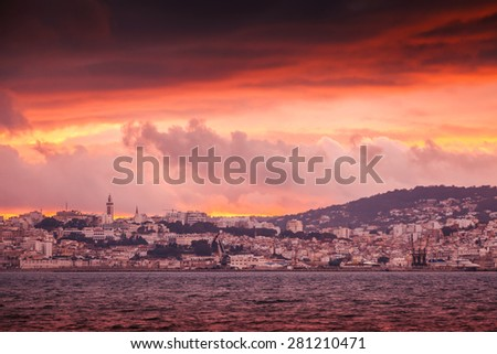 Bright red sunset sky over Tangier city, Morocco. Red tonal correction photo filter effect - stock photo