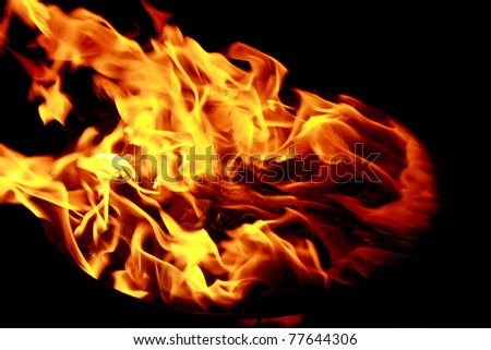 Bright red yellow fire flames on black background - stock photo