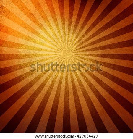 bright retro sunburst design in orange gold and brown - stock photo