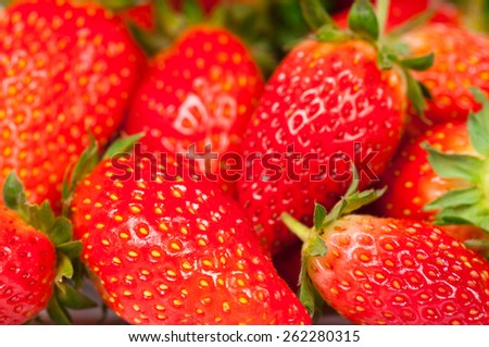 Bright ripe strawberries close-up. Focus on the forefront - stock photo