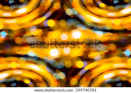 Bright round defocused colored lights on black background - stock photo