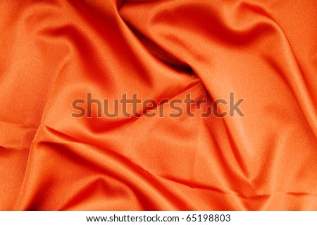 Bright satin fabric folded to be used as background - stock photo