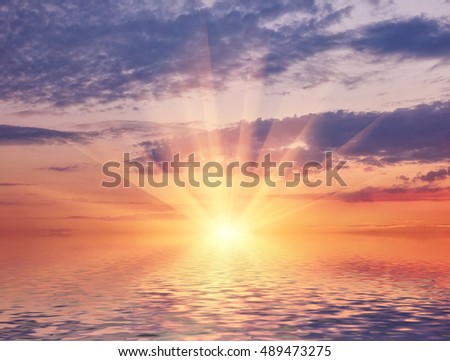 Bright sea sunset on the background of the beautiful sky and sun