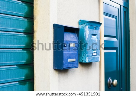 Bright shabby postboxes on the wall  - stock photo