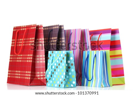 bright shopping bags isolated on white - stock photo