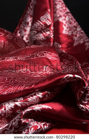 Bright silk fabrics with eastern pattern - stock photo