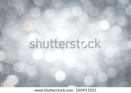 Bright Silver Abstract Christmas Background With White Snowflakes - stock photo
