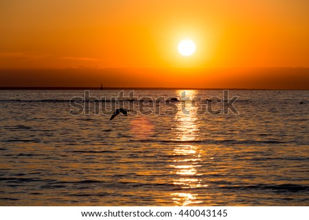 Bright sky and water at sunset over Baltic sea of Tallinn, Estonia - stock photo