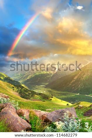 Bright sky during sundown in mountain valley. - stock photo