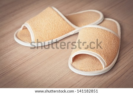 bright slippers, on floor background - stock photo