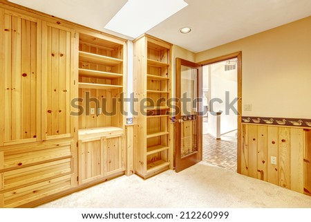 Bright small office room with skylight and light wooden cabinets. - stock photo