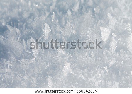 Bright snow background with ice crystals - stock photo