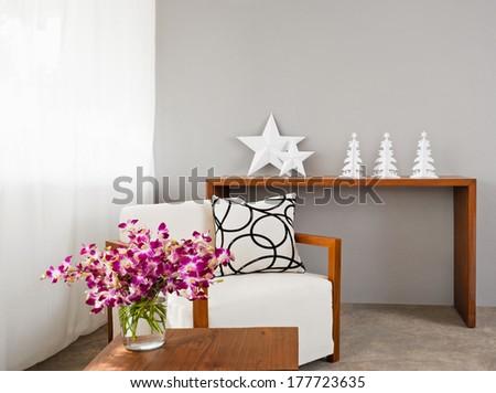 Bright sofa seat in grey bright setting - stock photo