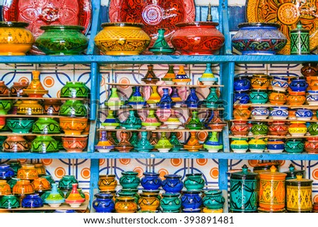 Bright souvenirs at the gift shop in the historic district of the medina - stock photo