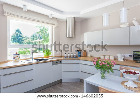 Bright space - a bright and spacious kitchen with a view of a garden - stock photo