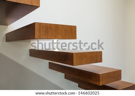 Bright space - a closeup of modern geometric wooden brown steps - stock photo