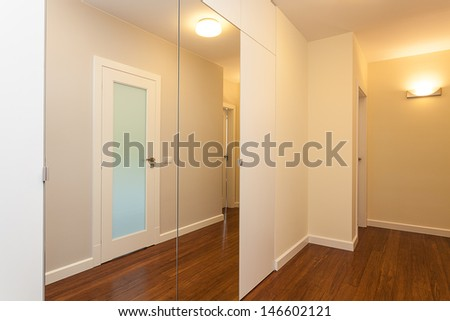 Bright space - a mirror hall in an elegant house - stock photo