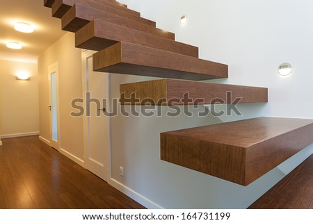 Bright space - brown wooden steps in a modern apartment - stock photo