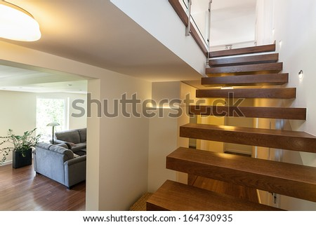 Bright space - lit up stairs in an elegant mansion - stock photo