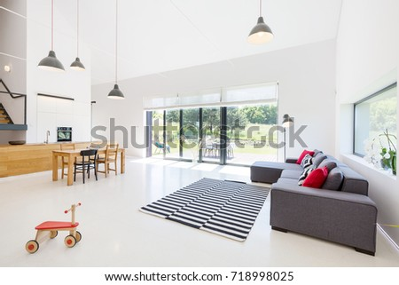 Bright spacious living room with open access to kitchen