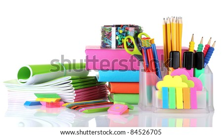 bright stationery and books isolated on white - stock photo