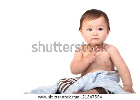 bright studio portrait of adorable baby wrapped in blanket - stock photo
