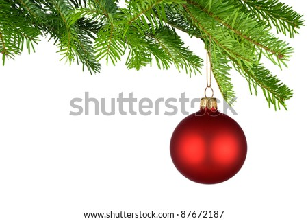 Bright studio shot of an isolated red Christmas bauble hanging from fresh green fir twigs - stock photo