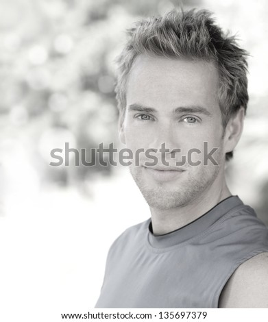 Bright stylized outdoor portrait of a handsome young confident man - stock photo