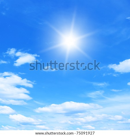 Bright sun and blue sky. - stock photo